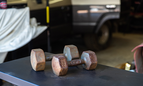 Rusted weights on a bench